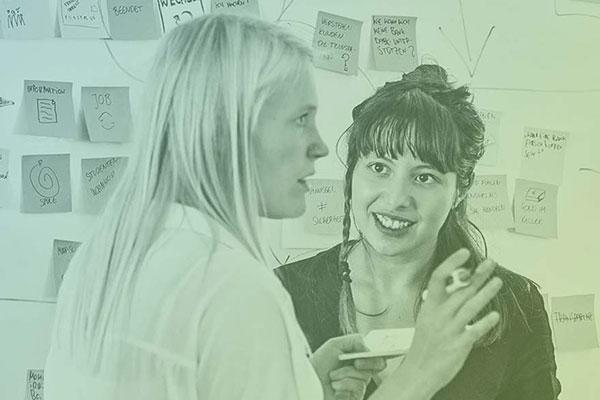 Grafik einer Workshop Situation mit glücklichen, lächelnden Menschen
